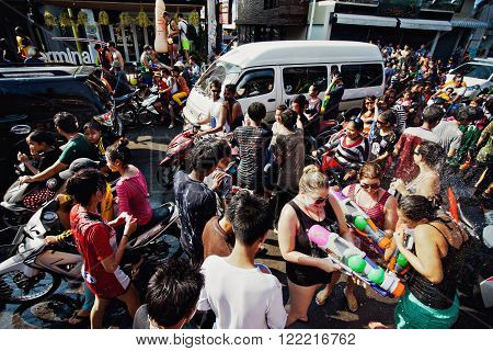 KO SAMUI, THAILAND - APRIL 13: Chaweng Main Road during the celebration of the water fight festival or Songkran Festival (Thai New Year) on April 13, 2014 in Ko Samui island, Thailand.