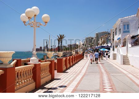 BENALMADENA, SPAIN - JUNE 2, 2008 - View along the cafe lined promenade and beach Benalmadena Costa del Sol Malaga Province Andalusia Spain Western Europe, June 2, 2008.