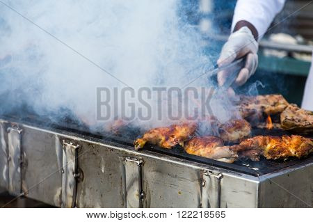 Sizzling Meat Being Cooked on a Barbecue Grill
