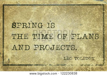 Spring is the time of plans and projects - famous Russian writer Leo Tolstoy quote printed on grunge vintage cardboard