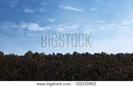Soil surface over sky background with copy space