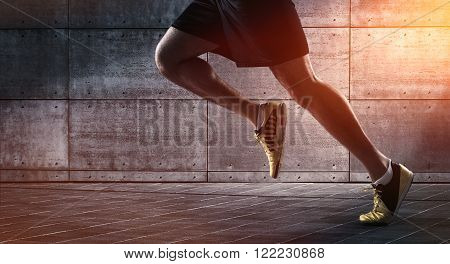 Close up of urban runner's legs running on the street with copy space