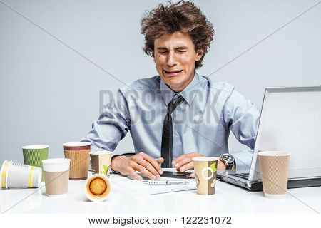 Crying man. Negative emotion facial expression feeling. Modern office man at working place depression and crisis concept