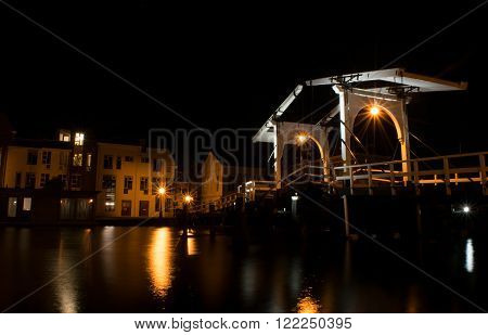 Night shot of the Rembrandt bridge crossing over the Rijn river in Leiden Netherlands