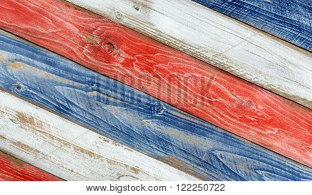 Angled faded wooden boards painted red white and blue for patriotic concept of United States of America.