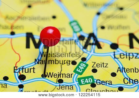 Photo of pinned Weimar on a map of Germany. May be used as illustration for traveling theme.