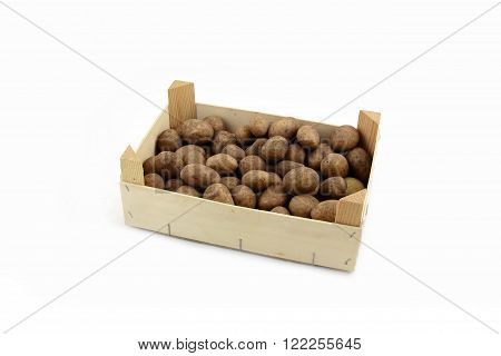 many fresh potatoes in a wooden box