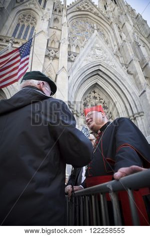 NEW YORK - MARCH 17, 2016: Timothy Cardinal Dolan Archbishop of New York speaks to a WCBS 880 news reporter in front of St Patricks Cathedral on Saint Patricks Day in Manhattan on March 17, 2016.