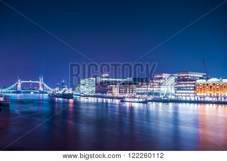 View of tower bridge and HMS Belfast from london bridge shot taken at night on a clear sky