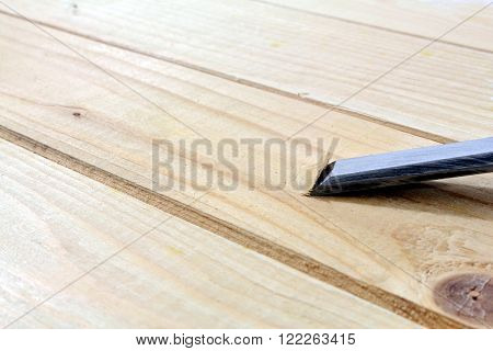 a metal planer on a wood boards