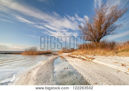 blue sky in evening by Ijsselmeer lake Netherlands