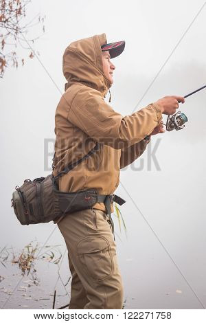 Sport fishing on the river, a fisherman with a spinning, active rest.