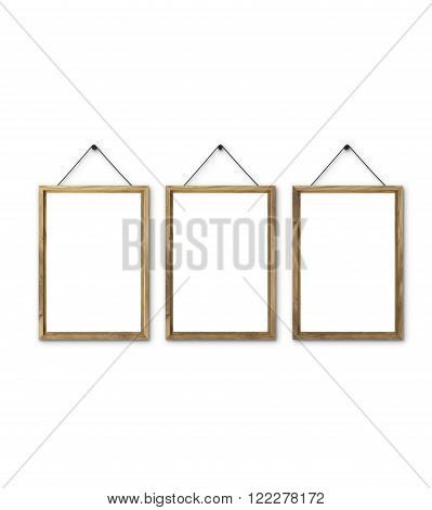 Three blank wooden frames on nails. Isolated. Concept of picture on wall. Mock up. 3D render
