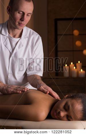 Woman And Deep Tissue Massage