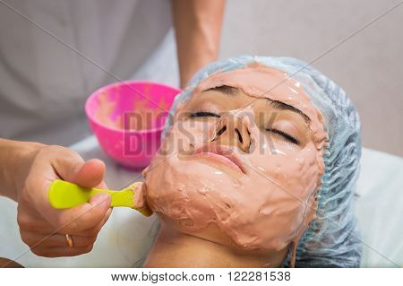 Rejuvenation, revitalization, skin nutrition. The concept of skin care. Cosmetology, cosmetology procedures, cosmetology conducts the procedure. Mask, beauty cream.