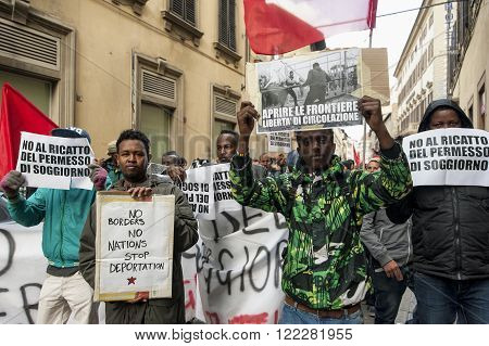 Florence Italy - March 12 2016: A march of immigrants in the downtown streets, against war, demanding rights and freedom.