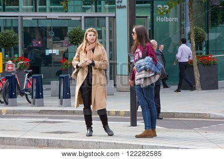 LONDON, UK - SEPTEMBER 19, 2015: Tow woman talking in Holborn