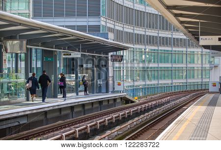 LONDON, UK - SEPTEMBER 17, 2015: People at the DLR station, light train railway of London