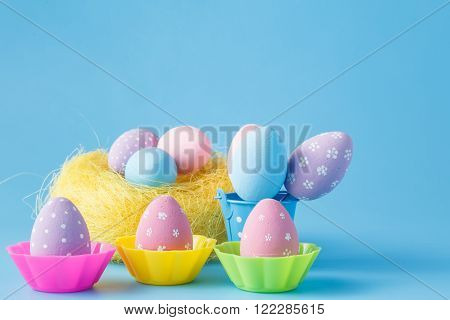 Colored easter eggs on a blue background