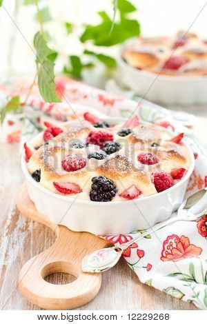 Fruit pudding(clafoutis) with berry: strawberry; raspberry; blueberry; blackberry