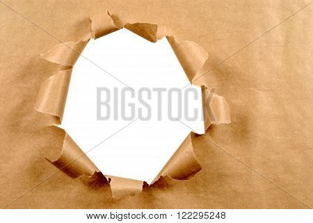 Brown torn paper background with untidy hole, white copy space