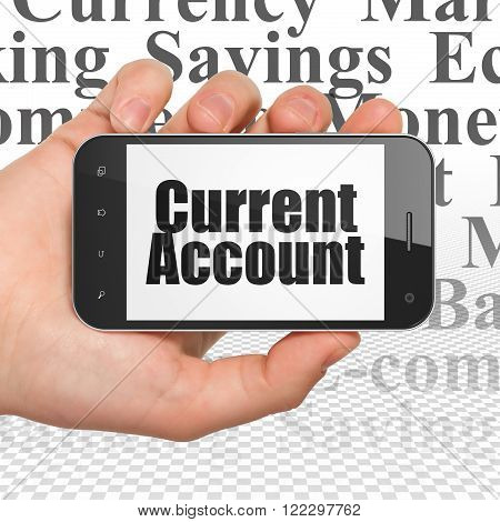 Currency concept: Hand Holding Smartphone with Current Account on display