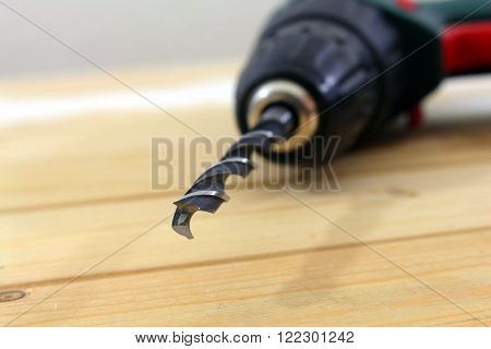 close up of a drill on wood