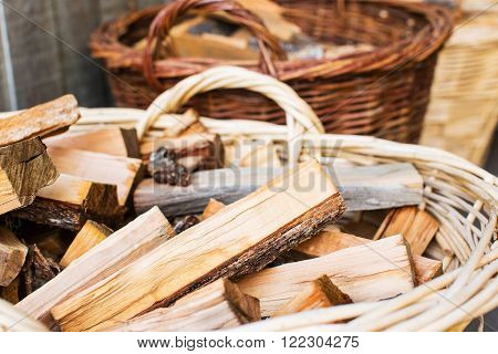 basket full of wooden logs for fireplace