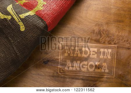 Made in Angola. The national flag of Angola stylized sackcloth.