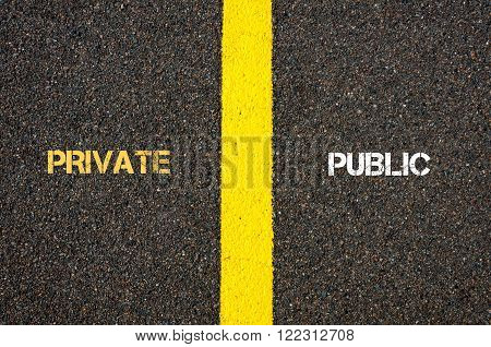 Antonym concept of PRIVATE versus PUBLIC written over tarmac, road marking yellow paint separating line between words