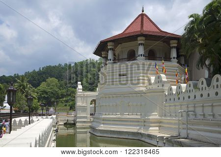 KANDY, SRI LANKA - MARCH 17, 2015: Royal Palace in the city of Kandy. Tower cloudy day closeup. The main attraction of the city of Kandy
