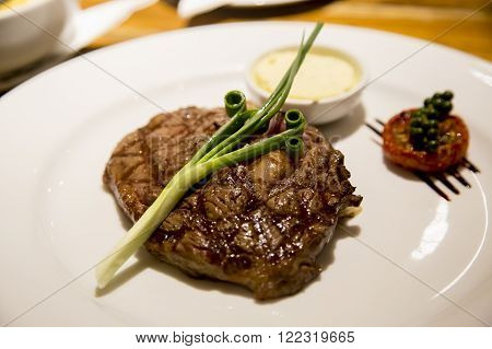 Rib Eye steak served with a spring onion and butter sauce