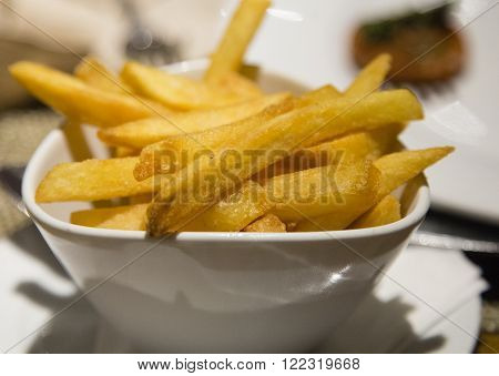 French fries (chips) close up served in a white bowl