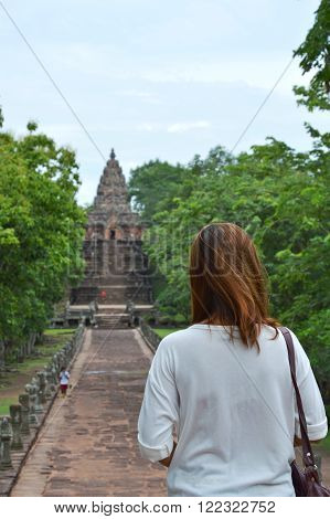woman tourist at entrance to Phanom Rung stone castle in Thailand