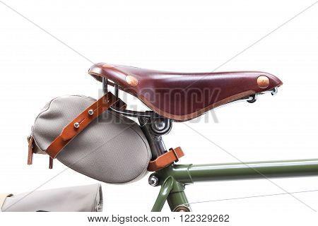 Vintage road bicycle saddle with under saddle bag, isolated on white.