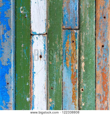 textured background of old wooden barn boards of different colors. square photo with copy space for text