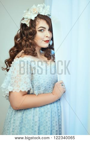Gentle young woman with overweight in dress. Soft focus with small depth of field.