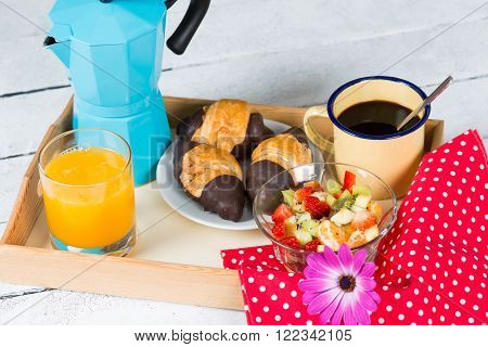 Breakfast tray with coffee and sweet fruit paste