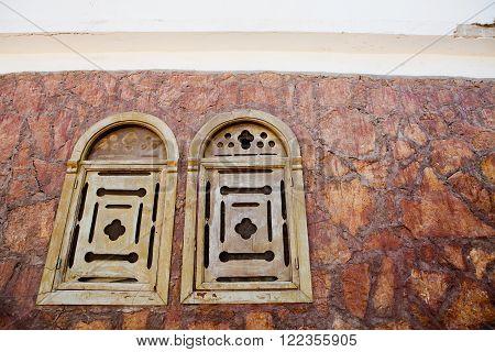 old wooden shutters on dark house in Egypt