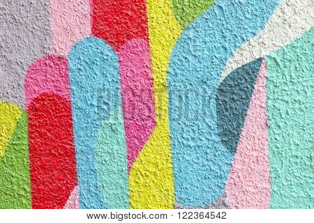 Background image of a colorful abstract drawing on a wall.