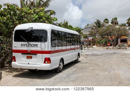 ST.MAARTEN, CARRIBEAN - AUGUST 2: Hyundai bus standing near Bikini beach entrance on Orient Bay (Baie Orientale) area  in Sint Maarten inAugust 2, 2015 in St.Maarten, Caribbean Island.