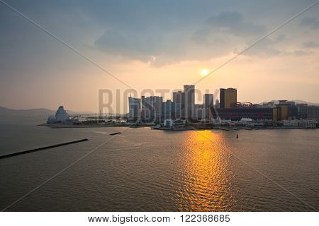 MACAO, MACAO - SEPTEMBER 28: Skyline of Macao cityscape at outer harbour before sunset on September 28, 2012