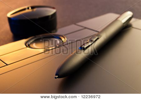 closeup of graphic tablet with pen and holder