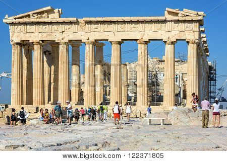 ATHENS, GREECE - AUGUST 16, 2015: Tourists visit Parthenon temple at the Acropolis in Athens, Greece