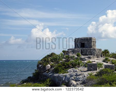 The Mayan temple El Castillo in the archeological Tulum complex on a cliff off the Caribbean sea Yucatán Peninsula Mexico.