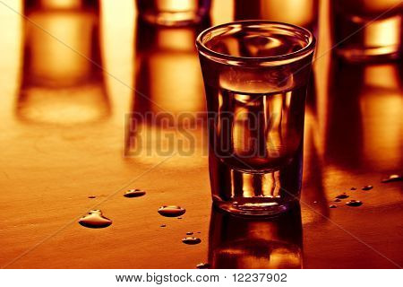 drink shots with reflection and drops in warm light
