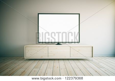 Light wooden TV cabinet with blank white TV in room interior. Mock up 3D Render