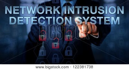 Administrator is pushing NETWORK INTRUSION DETECTION SYSTEM on a touch screen interface. Business metaphor and information technology concept for software monitoring a computer network for attacks.