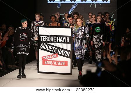 ISTANBUL TURKEY - MARCH 16 2016: Deniz Berdan with no terror no violence banner after her show in Mercedes-Benz Fashion Week Istanbul