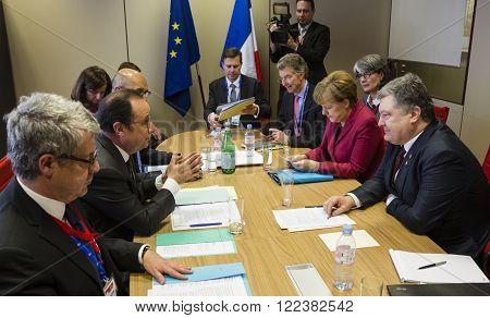 Petro Poroshenko, Francois Hollande And Angela Merkel